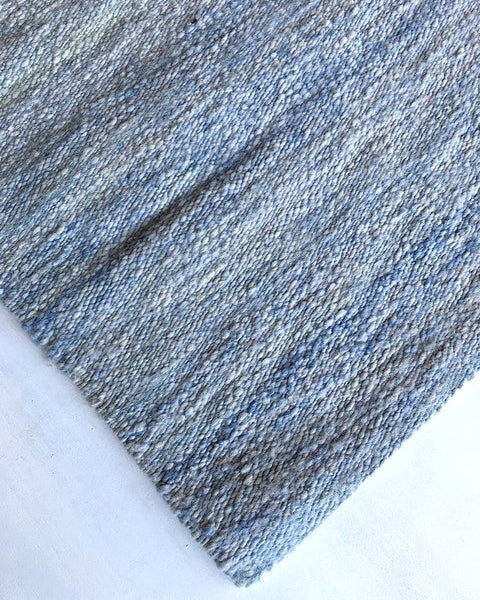 Handwoven wool rug light blue