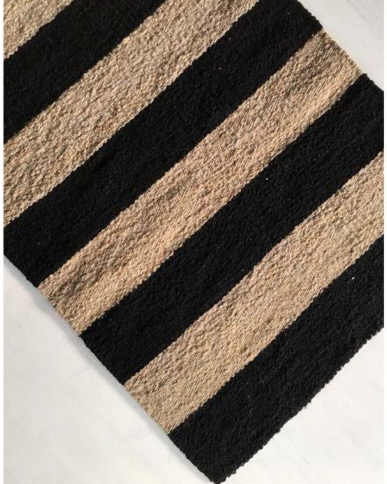 Handwoven wool rug black and beige