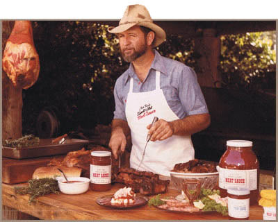 J. Lee Roy, himself, givin' a wink and carvin' up some barbeque