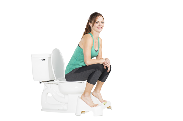 Model sitting on TURBO™ Toilet Footstool Bathroom Step Stool