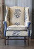 Antique Stretcher Base Wing Back Chair