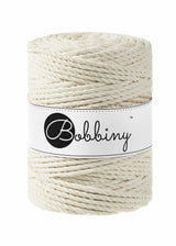 This superb new product from Bobbiny is the latest addition to their gorgeous range of products.  Made from 100% recycled cotton, it is perfect for Macrame projects due to its sturdiness. It contains no harmful dyes or chemicals and is OEKO-TEX certified.  This super soft triple twist rope also makes the most spectacular fringes and tassels.  Length: 100m (108 Yards)  Weight: 800gms  Contains 120 Fibres ( 3x40 )  Also available in 3mm