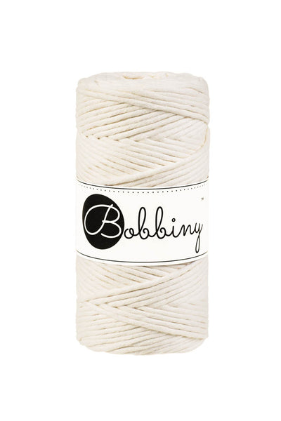 This super soft cord is perfect for Macrame or any other fibre art, and makes the most spectacular fringes and tassels.  It is made from 100% recycled cotton, is single twist and contains 56 individual fibres.  It contains no harmful substances and is approved to Oeko-Tex standards.  The inner spool is made from recycled paper and is biodegradable.  Length 100m (108 yards)  Weight 330 gms  Consistent colour guaranteed