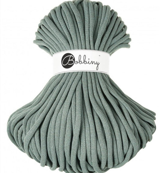 Where can I find Bobbiny Braided Cords Bobbiny Jumbo 9mm - 100m Laurel? These gorgeous Bobbiny Ropes are made in Poland from 100% recycled cottons and are non toxic and certified safe for children.  9mm Diameter  Length 100m  Recommended for use with 14-16mm crochet hooks or knitting needles. Perfect for use with Macrame, Crochet or Knitting.