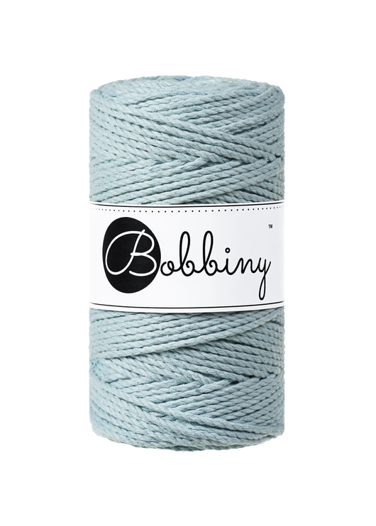 This superb new product from Bobbiny is the latest addition to their gorgeous range of products.  Made from 100% recycled cotton, it is perfect for Macrame projects due to its sturdiness. It contains no harmful dyes or chemicals and is OEKO-TEK certified.  This super soft triple twist rope also makes the most spectacular fringes and tassels.  Length: 100m (108 Yards)  Weight: 400gms  Contains 60 Fibres ( 3x20 )  Also available in 5mm