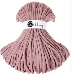 Where can I find Bobbiny Braided Cords Bobbiny Jumbo 9mm - 100m Blush? These gorgeous Bobbiny Ropes are made in Poland from 100% recycled cottons and are non toxic and certified safe for children.  9mm Diameter Length 100m Recommended for use with 14-16mm crochet hooks or knitting needles. Perfect for use with Macrame, Crochet or Knitting.