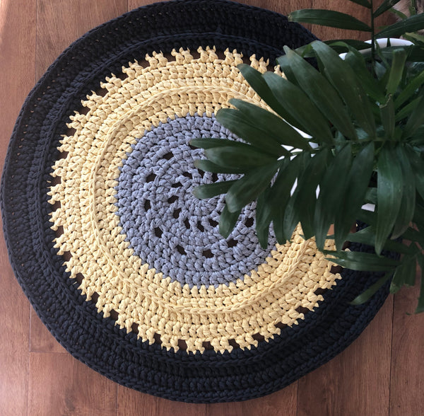 Where can I find a pattern You Are My Sunshine Floor Rug Pattern PDF? This pattern is designed using our T-shirt Yarn. Designed for advanced beginners, you will need a 12mm or similar crochet hook. You will receive a PDF copy via email within 24 hours after your order is complete, please use a valid email address for orders as this is the address that you will receive your PDF through.