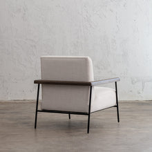 SAUVAGE ESSAN ARM CHAIR  |  SKIMMING STONE WHITE FABRIC  |  LOUNGE CHAIR REAR ANGLE VIEW