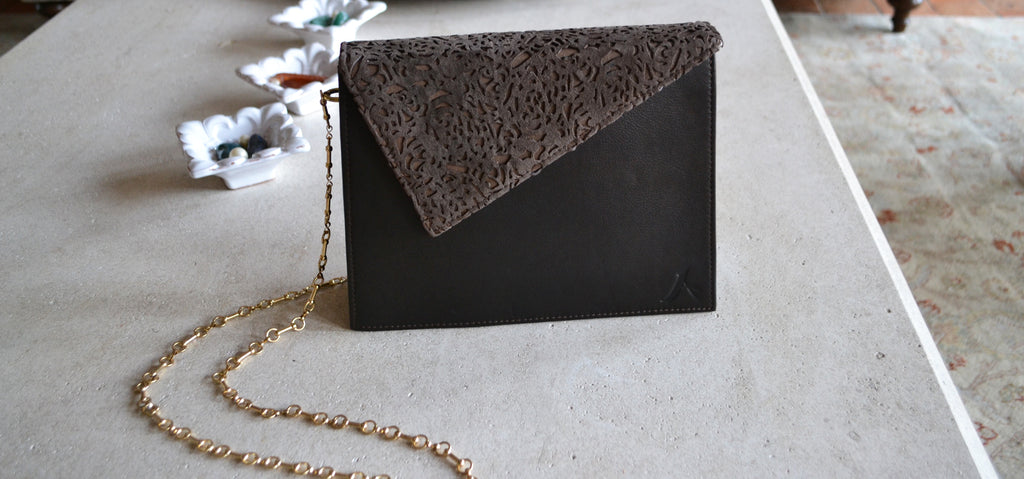 THE A ELEGANT CLUTCH UNIQUE AS YOU. Three kind of Italian leather, made in Los Angeles