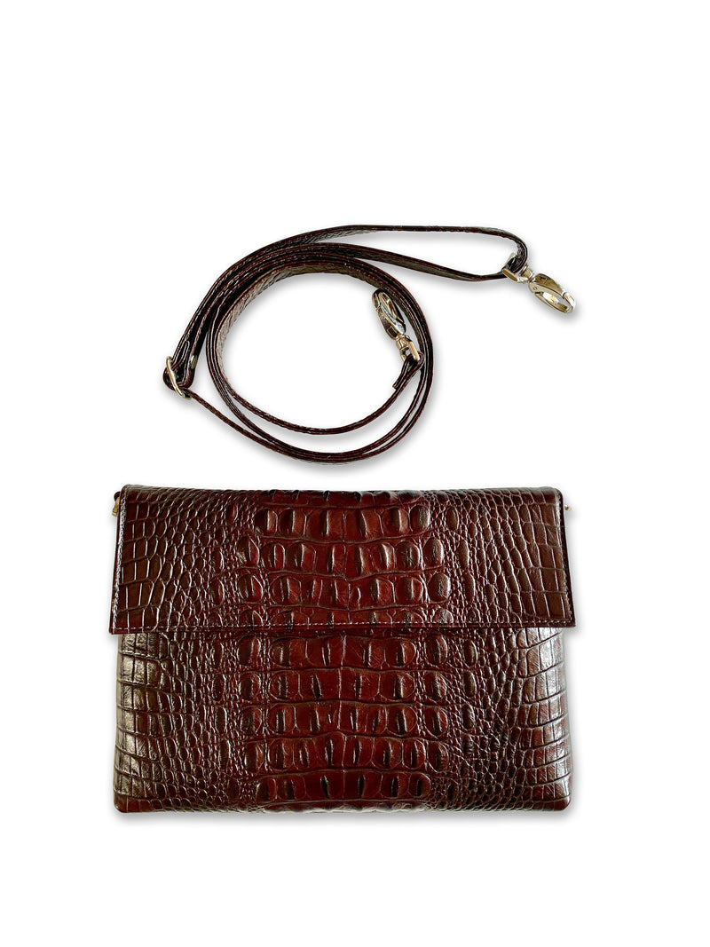 Croco Crossbody Bag made with Italian embossed leather features a classic and timeless design.