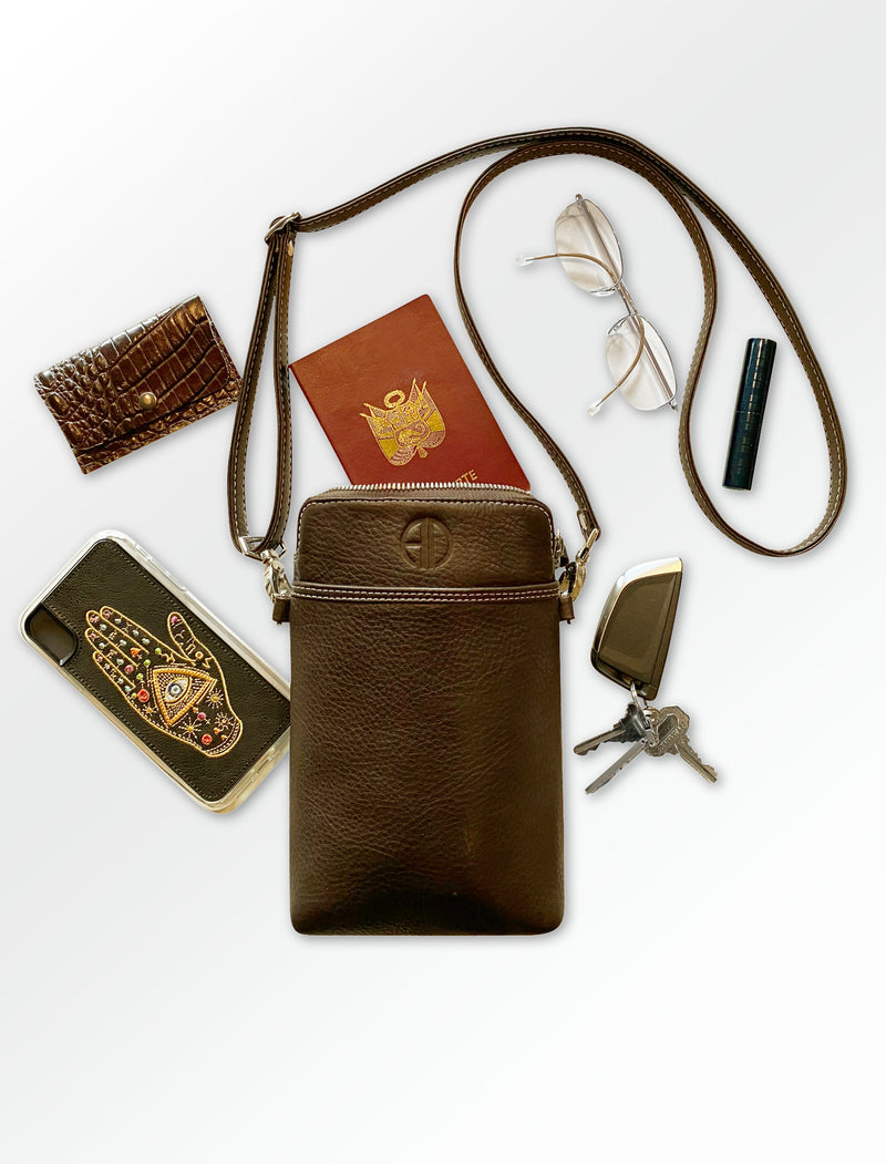 THE PASSPORT-XL Crossbody bag is handmade with genuine Italian leather in USA. It will keep your glasses, credit cards, keys, phone, make-up and passport protected. It can be used as a crossbody bag or around your neck for safety.