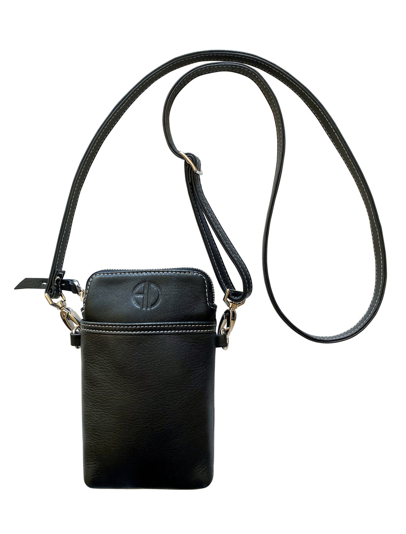 THE PASSPORT-XL Crossbody bag is handmade with premium Italian leather in USA. It will keep your glasses, credit cards, keys, phone, make-up and passport protected. It can be used as a crossbody bag or around your neck for safety, which makes this bag perfect for airports, concerts, festivals, or a long walk.