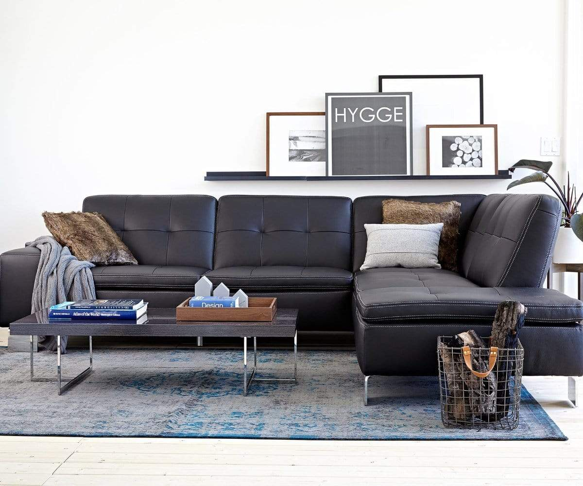 Large plush black leather living room sofa sectional
