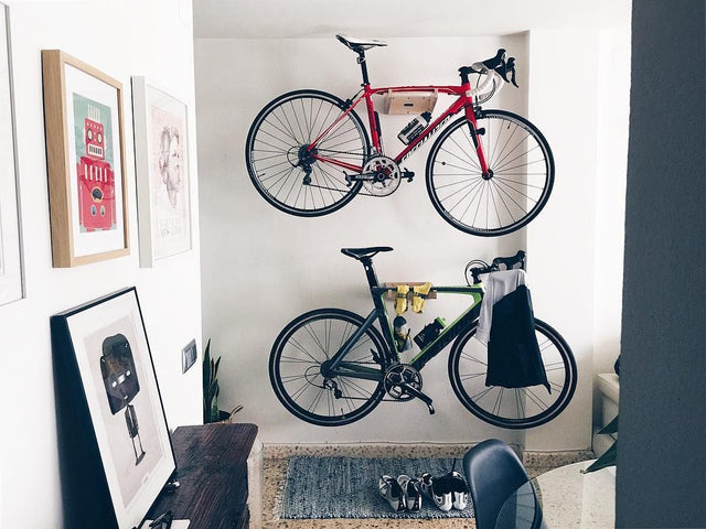 Bike wall mount holding two bicycles horizontal on the wall