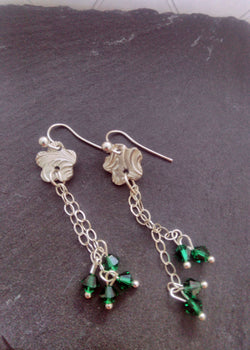 Silver flower and Swarovski green beads