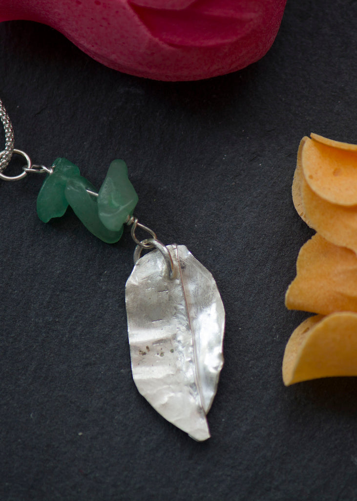 Silver leaf and green gemstone
