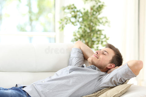 a relaxed man lying on a couch