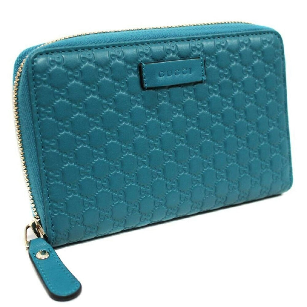 Gucci Cobalt Blue Microguccissima Embossed GG Leather Zip Around Wallet 449423 at_Queen_Bee_of_Beverly_Hills