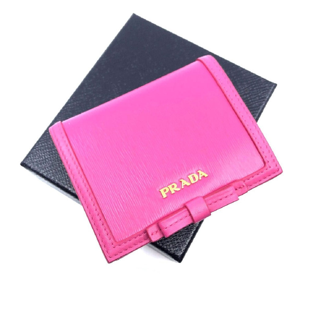 Prada Portafoglio Verticale Fuxia Pink Leather Flap Bow Wallet 1MV204 at_Queen_Bee_of_Beverly_Hills