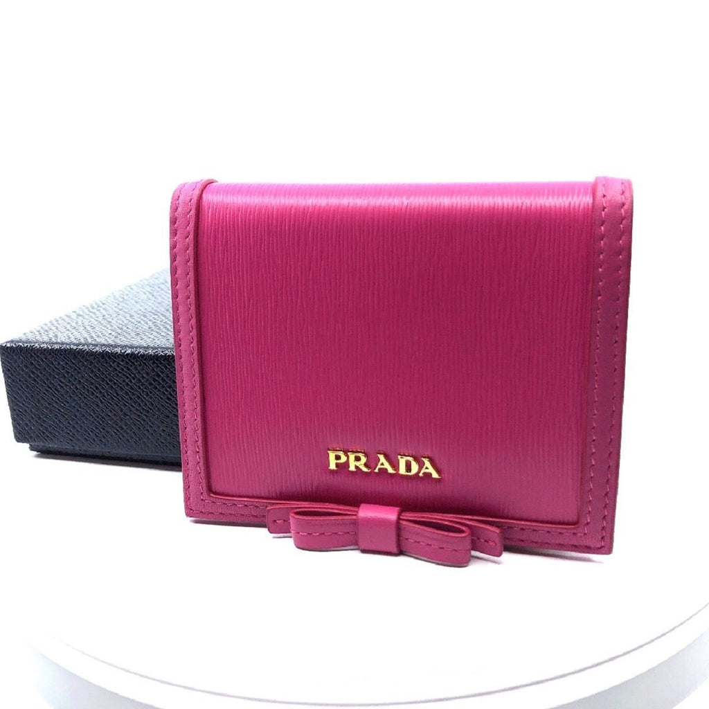 Prada Portafoglio Verticale Fuxia Pink Leather Vitello Move Flap Bow Wallet 1MV204 at_Queen_Bee_of_Beverly_Hills