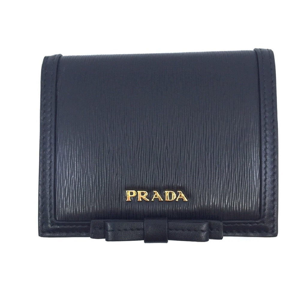 Prada Vitello Move Leather Bi Fold Flap Bow Front Snap Close Wallet 1MV204 at_Queen_Bee_of_Beverly_Hills