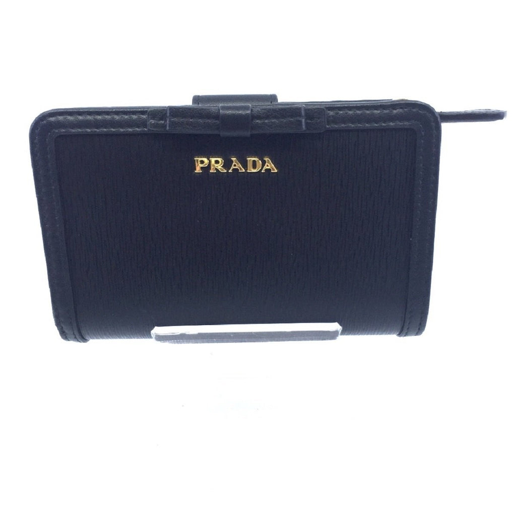 Prada Women's Vitello Move Black Bow Trim French Flap Zipper Wallet 1ML225 at_Queen_Bee_of_Beverly_Hills