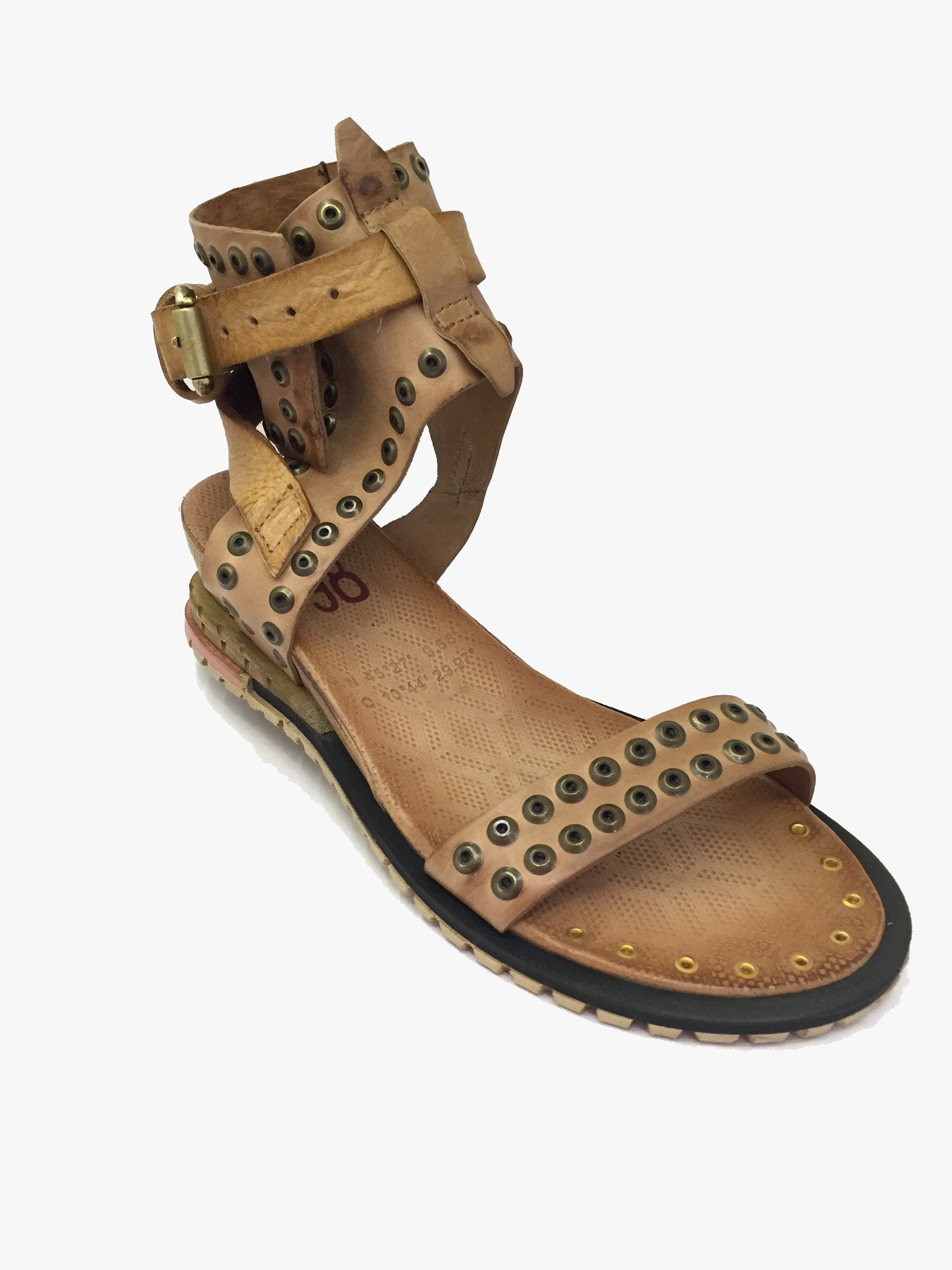 A.S.9.8 Nude leather sandal with 2 inch/5cm wedge. Double studded detailing across front strap. Thick strap with studded detailing around ankle. Light tan criss cross strap with single buckle fastening. Some gold studded detailing on toe area. Exclusive brand.