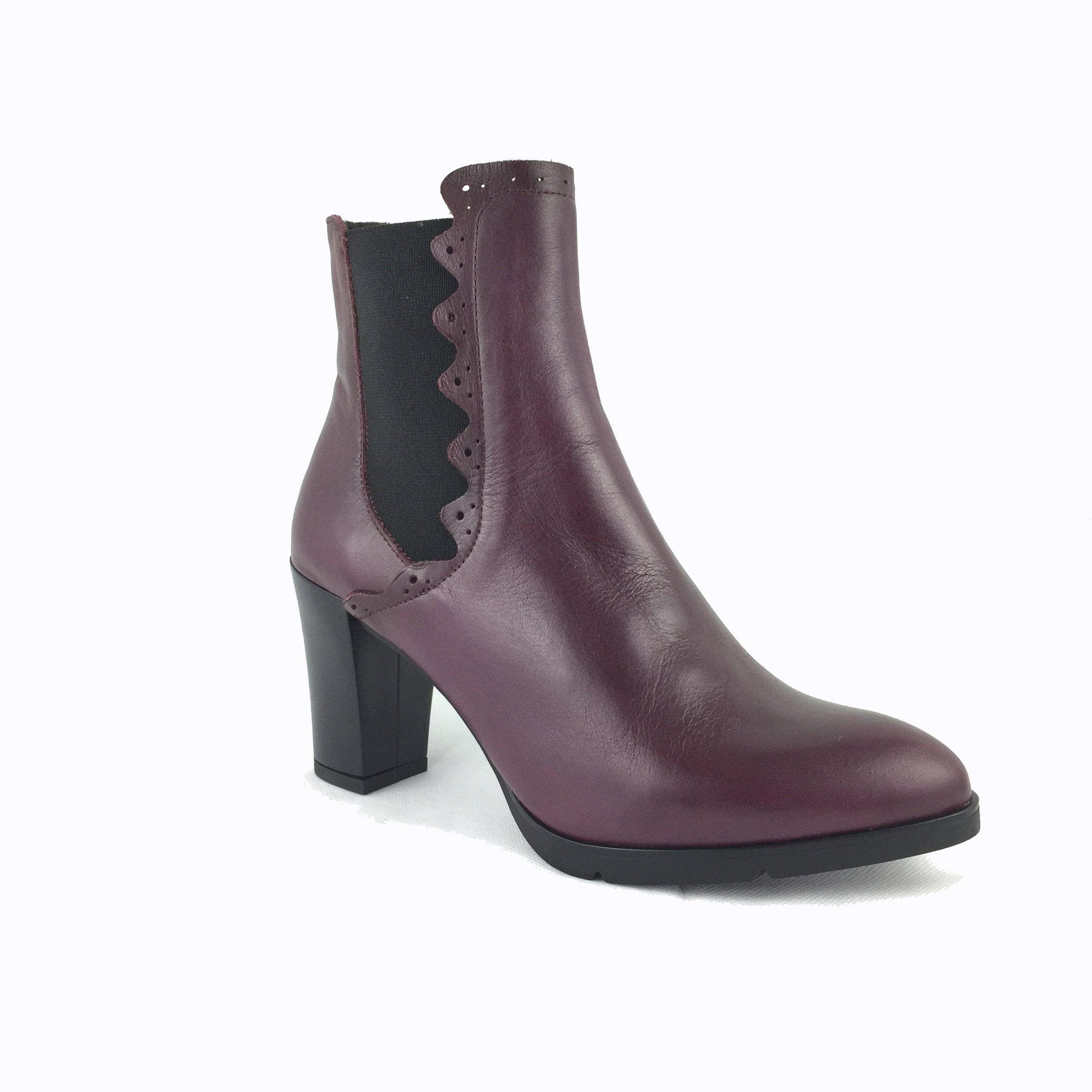 Cherrypic Wine leather mid heel ankle boot. With black elastic sides and frill detailing. Black wooden effect heel.