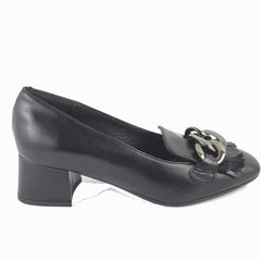 Cherrypic black leather Gucci inspired heeled loafer. Front silver buckle with fringe design underneath. Square shaped toe design. Low block heel.