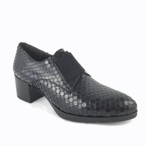 Cherrypic black leather mid heel loafer. Crocodile skin effect, black wooden effect block heel. Slip on with elastic front. Rounded toe. Perfect work wear.