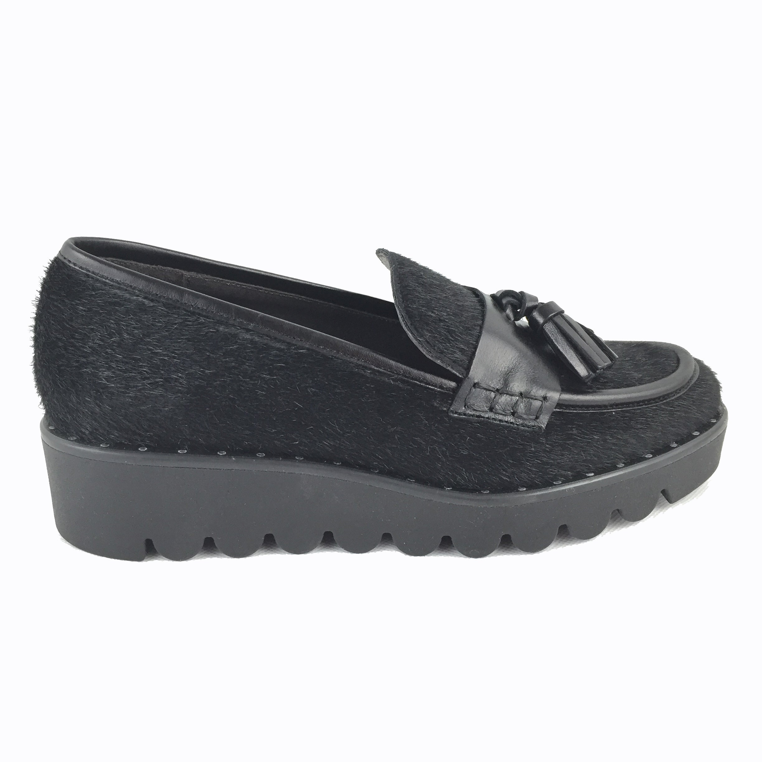 Cherrypic Black slip on Loafer. Slip on with black slight wedged sole. Front tassels and pony hair design.