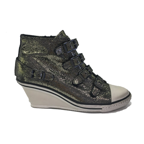 ASH Silver glitter coated sneaker. Zip fastening with decorative buckles. Rubber sole with white toe cap. Wedge height measures 2inches/5cm