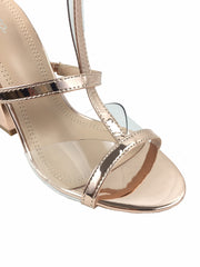 Migato rose gold mirrored block heels with see through front. Open toe, ankle strap buckle fastening.