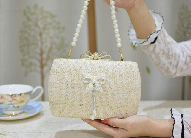 Rdywbu Women's Straw Pearl Bowknot Straw Woven Evening Clutches Rhinestones Beaded Wedding Party Purse Chain Handbag Bolsa H07