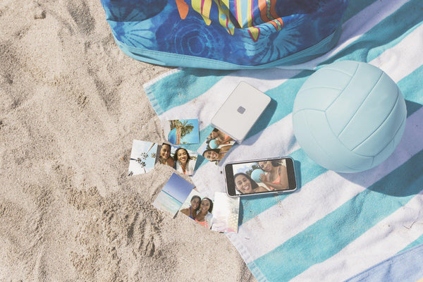 Lifeprint printer and photos on beach scene