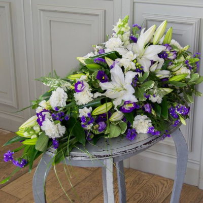 White Lily with Blue and Lime Single Ended Spray to Gerald Burden Funeral Directors