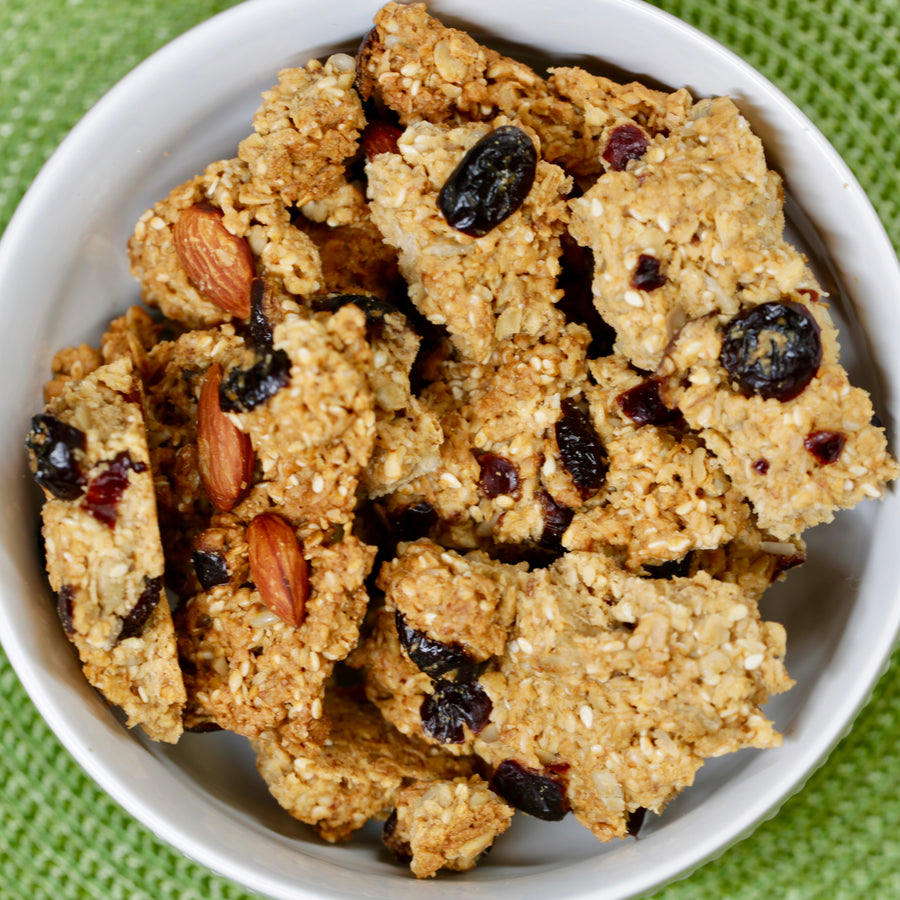 Big Sky Bread Company Whole Grain Granola. A whole grain oatmeal base featuring apple juice sweetened cranberries, California almonds, wildflower honey and a perfect blend of sesame and sunflower seeds.