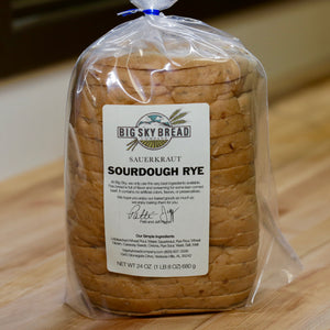 Big Sky Bread Company Sauerkraut Sourdough Rye Bread. Screaming for some lean corned beef! This loaf has so much flavor... it's loaded with onions, caraway seeds, and sauerkraut.