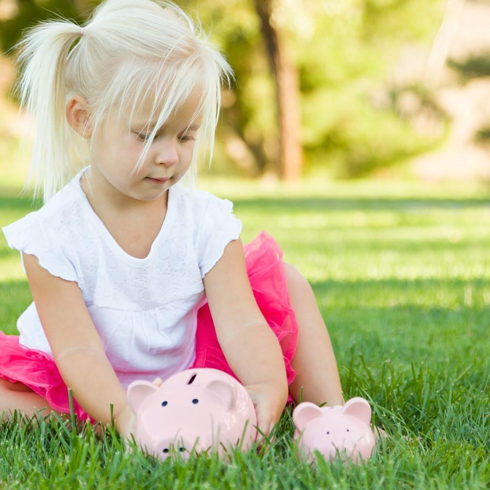 toddler with a piggy bank