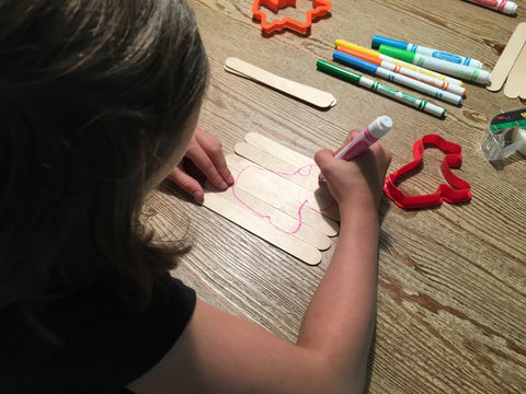 Kids drawing on the popsicle sticks