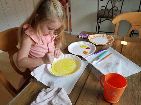 Rainy day sun catchers: painting paper plate