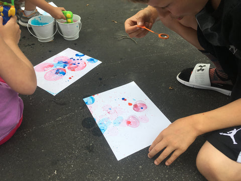kids blowing colored bubbles on paper 1