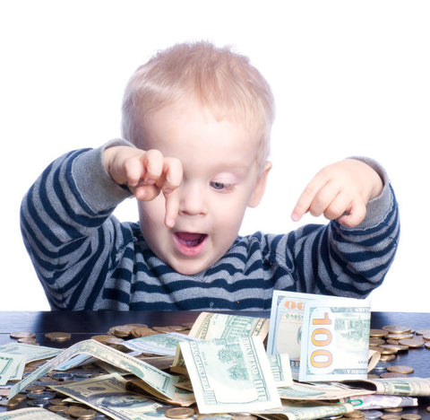 Young boy playing with money