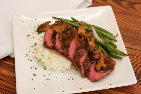 Beef with Wild Mushroom Porter Sauce with Havarti Chive Mashed Potatoes and Green Beans with Roasted Red Peppers