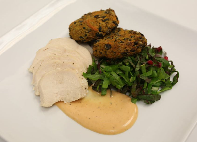 Roasted Chicken with Chipotle Honey Aioli, Sweet Potato Black Bean Cakes, and Roasted Greens