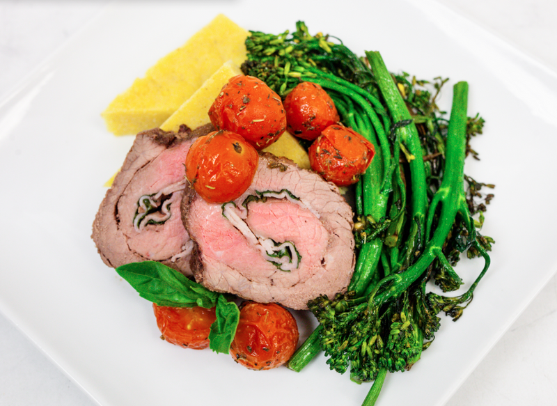 Steak Braciole Stuffed with Uncured Ham, Mozzarella, & Basil with Polenta Cake, Roasted Broccolini, and Olive Oil Herb Roasted Tomatoes (Gluten Free)