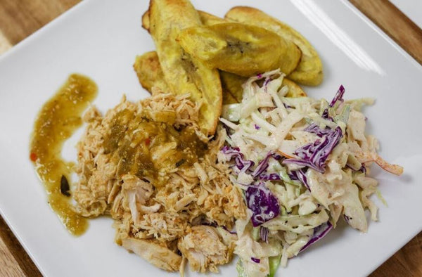 Mild Green Chili Braised Pork Loin with Roasted Sweet Plantains and Poblano Cabbage Slaw
