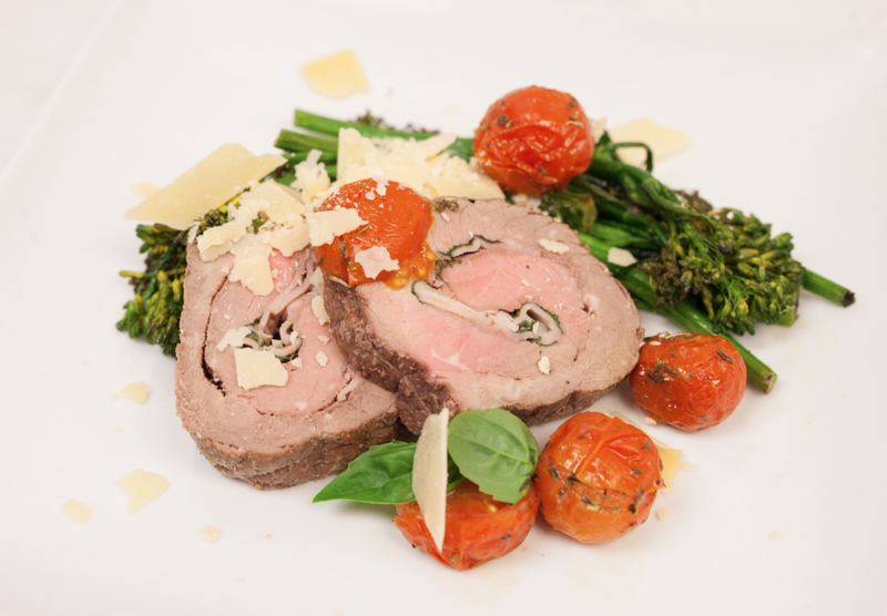 Steak Braciole Stuffed with Uncured Ham, Mozzarella, & Basil with Roasted Broccolini, Aged Parmesan, and Olive Oil Herb Roasted Tomatoes (Gluten Free)