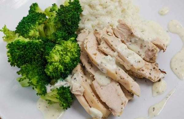 Herb Chicken Thigh with Shallot Cream Sauce over Whipped Potatoes with Blanched Broccoli