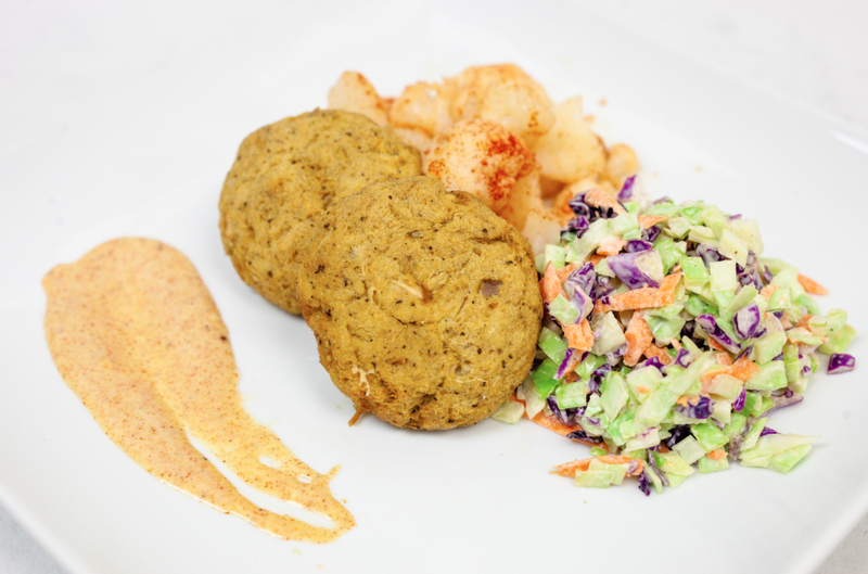 New England Crab Caked with Roasted Cauliflower, Classic Coleslaw, and Cajun Aioli Dip